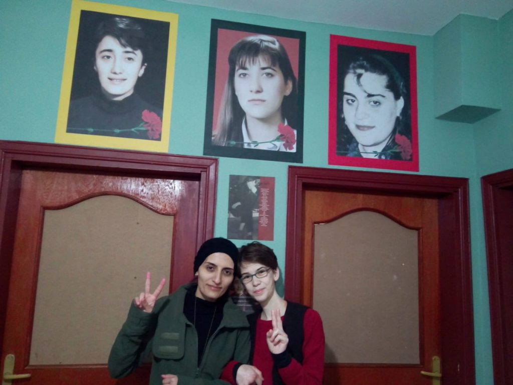 Helin(left) and Bahar(right) below the portraits of Ayse Gunel, Ayce Idil Erkmen and Ayse Gulen(from left to right)